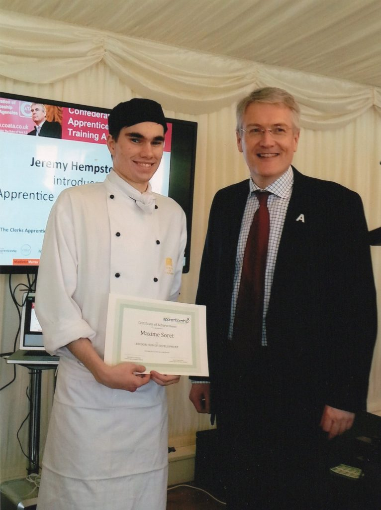 Maxim Soret (23) receiving his apprenticeship certificate