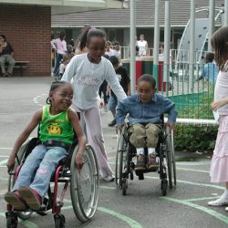 Children playing together, some in wheelchairs, some not