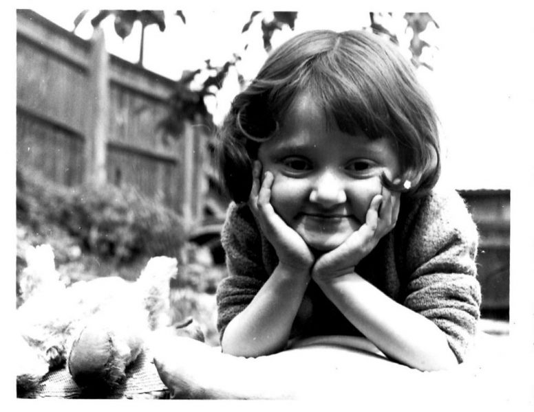 Micheline Mason (ALLFIE's former CEO) as a small child, smiling at the camera