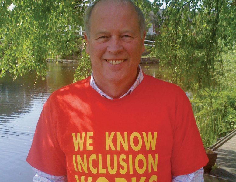 """Joe Whittaker wearing an ALLFIE t-shirt iwth the slogan """"we know inclusion works"""""""