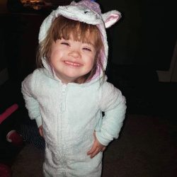 Ava in a bunny suit grinning