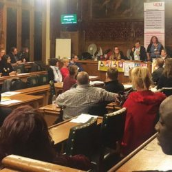 Committee room 10, a wood panelled room, at the House of Commons, full of attendees at the day of action
