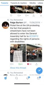 "Tweet from Paige Burton: ""Picket line at the UN protesting the fact that people in wheelchairs have not been allowed to enter the General Assembly hall for te #COSP12 regarding the rights of persons with disabilities"""