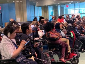 A large group of wheelchair users