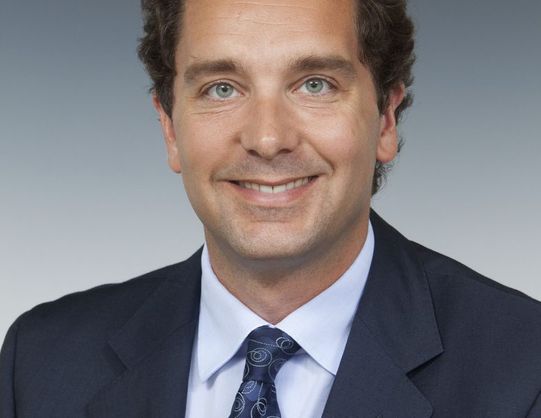 Edward Timpson, smiling at the camera, wearing a suit