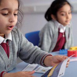 Two small girls in school unifocm in class