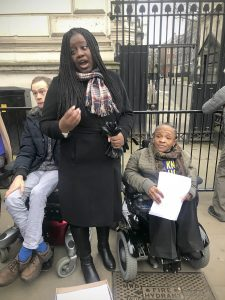 Marsha Cordova giving a speech outside the gates of Downing Street
