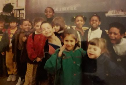 Historical image of Chloe McCollum at primary school with friends in the 1990s