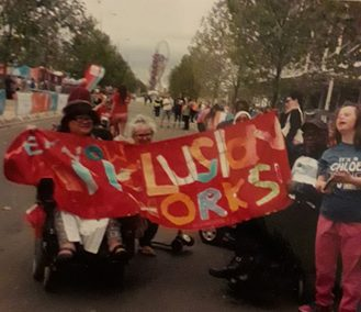 Historical image: Chloe McCollum, far right campaigns with ALLFIE for Inclusive Education at Olympic park event